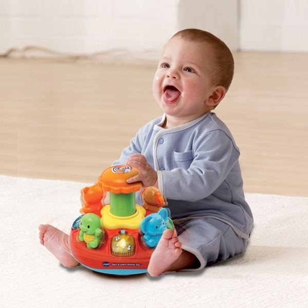 baby push and play spinning top toy vtech